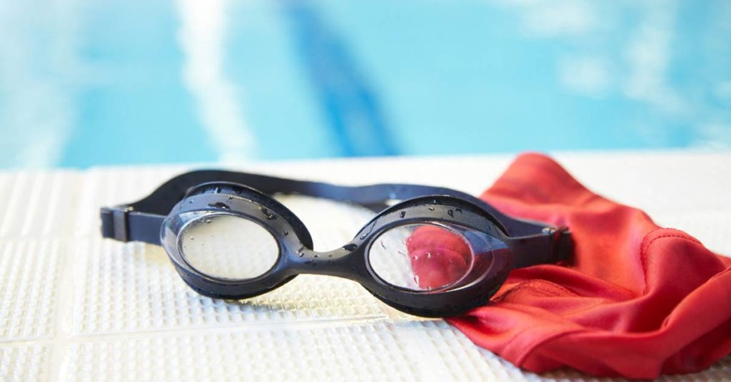 Goggles and red bathing cap