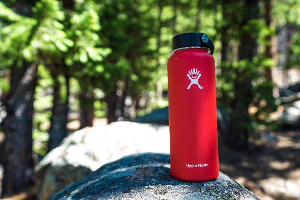 Red water bottle in woods
